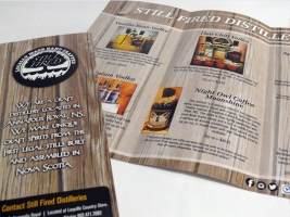 A tri-fold brochure designed for Still Fired Distilleries. This brochure was made to showcase their products and where to purchase them,  as well as tell a little bit about their background story.
